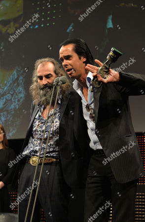 Warren Ellis and Nick Cave receive the Album of the Year Award at the 59th Ivor Novello Awards at the Grosvenor House in London on