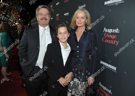 """John Wells, left, Marilyn Wells, right, and son arrive at The Weinstein Company's Los Angeles premiere of """"August: Osage County"""" in partnership with Bombardier at Regal Cinemas L.A. Live on"""