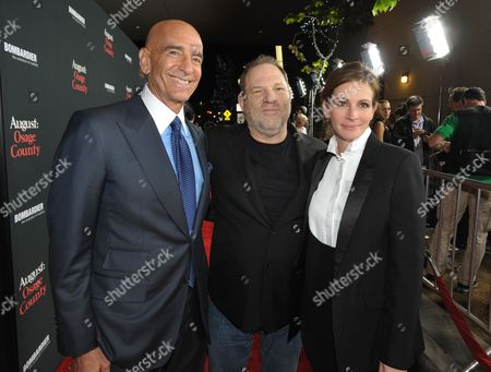 """From left, Tom Barrack, Chairman of Miramax, Harvey Weinstein, Co-Chairman, The Weinstein Company, and Julia Roberts arrive at The Weinstein Company's Los Angeles premiere of """"August: Osage County"""" in partnership with Bombardier at Regal Cinemas L.A. Live on"""