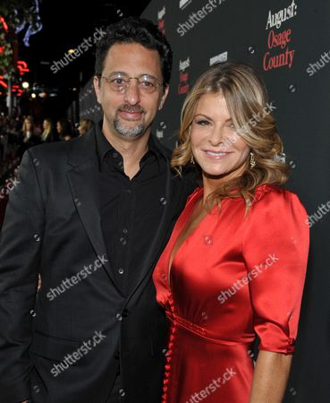 "Grant Heslov, left, and Lysa Heslov arrive at The Weinstein Company's Los Angeles premiere of ""August: Osage County"" in partnership with Bombardier at Regal Cinemas L.A. Live on"