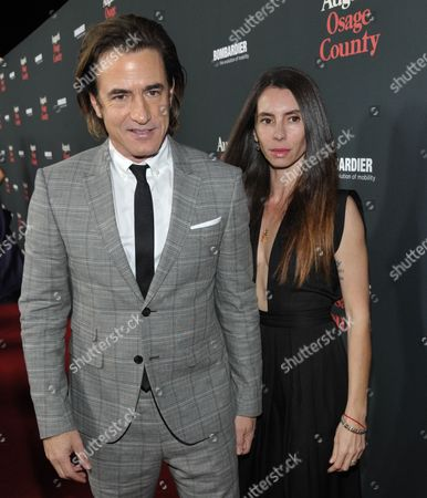 """Stock Image of Dermot Mulroney, left, Tharita Catulle arrive at The Weinstein Company's Los Angeles premiere of """"August: Osage County"""" in partnership with Bombardier at Regal Cinemas L.A. Live on"""