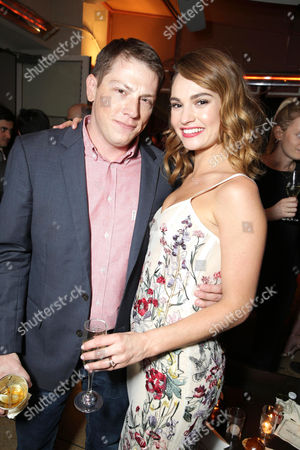 Author Seth Grahame-Smith and Lily James seen at The World Premiere of Screen Gems' 'Pride and Prejudice and Zombies' at Harmony Gold, in Hollywood, CA