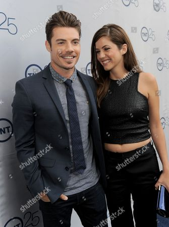 Josh Henderson, left, and Julie Gonzalo arrive at the TNT 25th Anniversary Party on at The Beverly Hilton in Beverly Hills, Calif