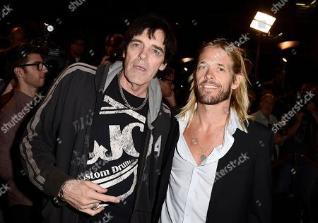 "Stock Photo of From left to right, musician Richie Ramone and musician Taylor Hawkins arrive on the red carpet at the West Coast special screening of ""CBGB"" at the ArcLight Hollywood on in Los Angeles"