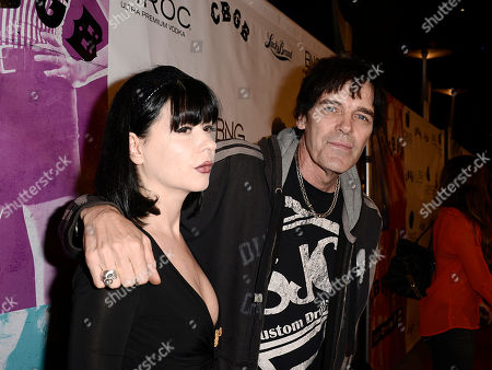 "Musician Richie Ramone and girlfriend arrive on the red carpet at the West Coast special screening of ""CBGB"" at the ArcLight Hollywood on in Los Angeles"