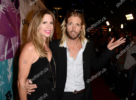 """Musician Taylor Hawkins and wife Alison Hawkins arrive on the red carpet at the West Coast special screening of """"CBGB"""" at the ArcLight Hollywood on in Los Angeles"""