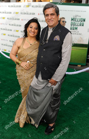 "Apara Mehta, left, and Darshan Jariwala arrive at the world premiere of ""Million Dollar Arm"" at El Capitan Theatre, in Los Angeles"