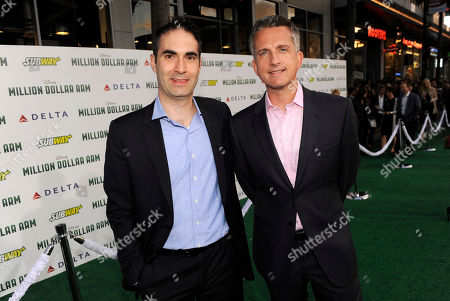 """Executive producers Connor Schell, left, and Bill Simmons arrive at the world premiere of """"Million Dollar Arm"""" at El Capitan Theatre, in Los Angeles"""