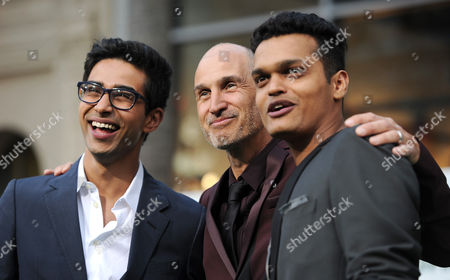 """Suraj Sharma, and from left, director Craig Gillespie and Madhur Mittal arrive at the world premiere of """"Million Dollar Arm"""" at El Capitan Theatre, in Los Angeles"""