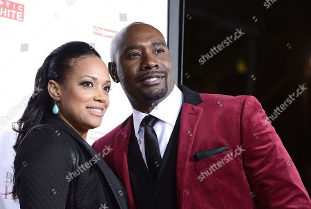 "Actor Morris Chestnut and wife Pam Byse arrive on the red carpet for the world premiere of the feature film ""The Best Man Holiday"" at the TCL Chinese Theatre on in Los Angeles"