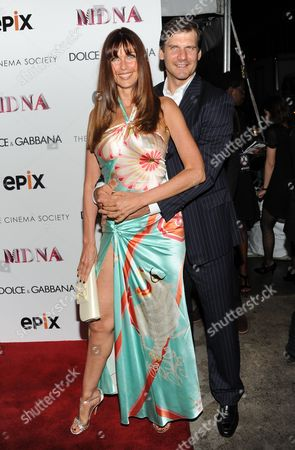 """Model Carol Alt and husband Alexei Yashin attend the world premiere of """"Madonna: The MDNA Tour"""" hosted by The Cinema Society and Dolce & Gabbana at the Paris Theatre on in New York"""