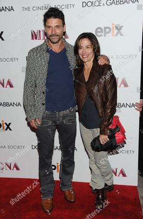 """Actor Frank Grillo and wife Wendy Moniz attend the world premiere of """"Madonna: The MDNA Tour"""" hosted by The Cinema Society and Dolce & Gabbana at the Paris Theatre on in New York"""