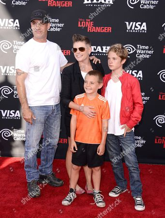"""From left to right, Actor Adrian Pasdar, musician Natalie Maines and children Jackson Slade Pasdar and Beckett Finn Pasdar arrive at the world premiere of """"The Lone Ranger"""" at Disney California Adventure on in Anaheim, Calif"""