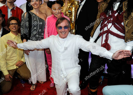 """Cirque du Soleil President & CEO Daniel Lamarre, center, arrives at the world premiere of """"Michael Jackson ONE"""" at THEhotel at Mandalay Bay Resort and Casino on in Las Vegas"""