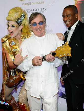 """Cirque du Soleil President & CEO Daniel Lamarre, center, and musical director Kevin Antunes, right, arrive at the world premiere of """"Michael Jackson ONE"""" at THEhotel at Mandalay Bay Resort and Casino on in Las Vegas"""