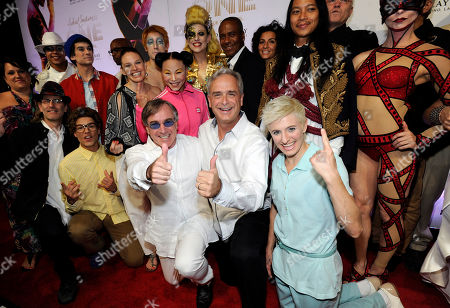 """Cirque du Soleil President and CEO Daniel Lamarre, left center, and Mandalay Bay Resort and Casino President and COO Chuck Bowling, center, arrive with cast members at the world premiere of """"Michael Jackson ONE"""" at THEhotel at Mandalay Bay Resort and Casino on in Las Vegas"""