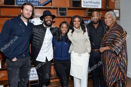"""Cast members, from left, Armie Hammer, Colman Domingo, Aja Naomi King, Gabrielle Union, Chike Okonkwo and Esther Scott pose together at """"The Birth of a Nation"""" cast party hosted by Chase Sapphire Preferred during the 2016 Sundance Film Festival, in Park City, Utah"""