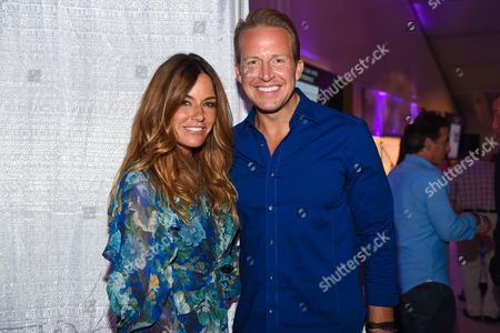 """Reality TV star Kelly Bensimon, left, and news anchor Chris Wragge attend the 11th annual """"A Hamptons Happening"""", benefiting the Samuel Waxman Cancer Research Foundation, at the Bridgehampton Estate of Maria and Kenneth Fishel, in New York"""