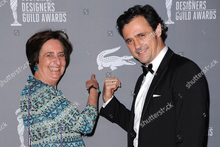 Beryl Lacoste Hamilton, left, and Francis Pierrel arrive at the 15th Annual Costume Designers Guild Awards at The Beverly Hilton Hotel on in Beverly Hills
