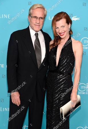 Randal Kleiser, left, and Tanna Frederick arrive at the 17th Costume Designers Guild Awards at the Beverly Hilton Hotel, in Beverly Hills, Calif
