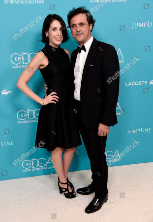 Coco Pierrel, left, and Francis Pierrel, president and CEO, Lacoste North America, arrive at the 17th Costume Designers Guild Awards at the Beverly Hilton Hotel, in Beverly Hills, Calif