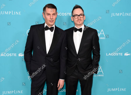 Kurt Swanson, left, and Bart Mueller, of costume design team Kurt and Bart, arrive at the 17th Costume Designers Guild Awards at the Beverly Hilton Hotel, in Beverly Hills, Calif