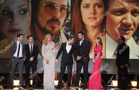 """From left, Alessandro Nivola, Shea Whigham, Elisabeth Rohm, Jeremy Renner, Bradley Cooper, Amy Adams and Paul Herman accept the award for best acting ensemble for """"American Hustle"""" at the 19th annual Critics' Choice Movie Awards at the Barker Hangar, in Santa Monica, Calif"""