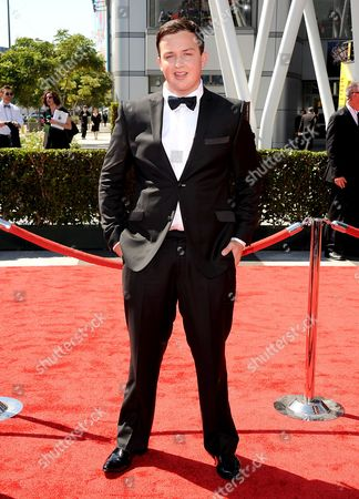 SEPTEMBER 15: Noah Munck arrives at the Academy of Television Arts & Sciences 64th Primetime Creative Arts Emmy Awards at Nokia Theatre L.A. Live on in Los Angeles, California