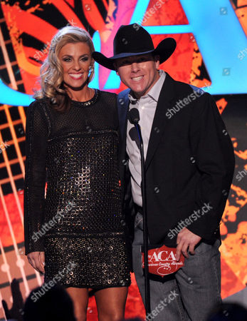 From left, Shada Brazile and Trevor Brazile speak onstage at the American Country Awards at the Mandalay Bay Resort & Casino, in Las Vegas, Nev