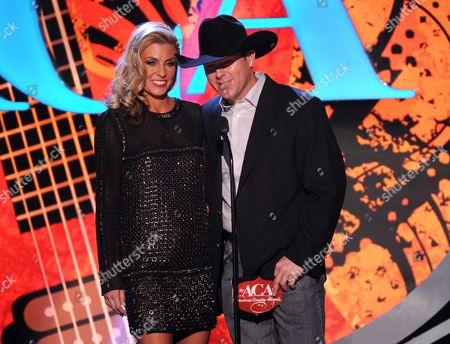 Stock Photo of From left, Shada Brazile and Trevor Brazile speak onstage at the American Country Awards at the Mandalay Bay Resort & Casino, in Las Vegas, Nev