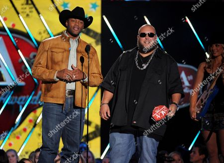 Big Smo, right, and Cowboy Troy present the award for album of the year at the American Country Awards at the Mandalay Bay Resort & Casino, in Las Vegas, Nev