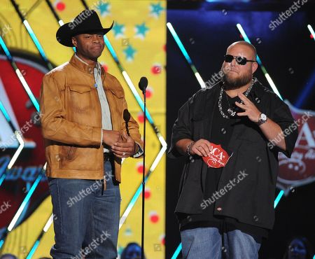 From left, Cowboy Troy and Big Smo speak onstage at the American Country Awards at the Mandalay Bay Resort & Casino, in Las Vegas, Nev