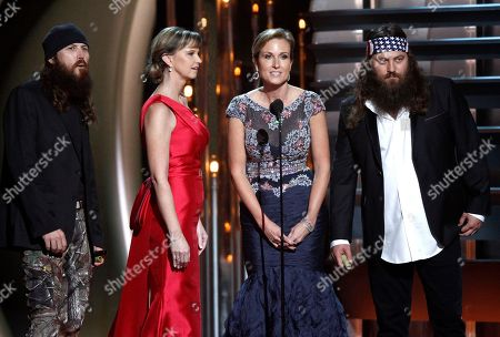 """Duck Dynasty"""" cast members, from left, Jase Robertson, Missy Robertson Korie Robertson and Willie Robertson speak onstage at the 47th annual CMA Awards at Bridgestone Arena, in Nashville, Tenn"""