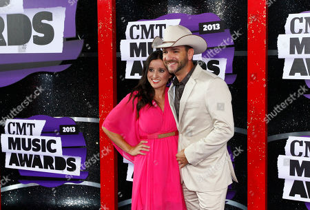 Mindy Ellis Campbell, left, and Craig Campbell arrive at the 2013 CMT Music Awards at Bridgestone Arena, in Nashville, Tenn
