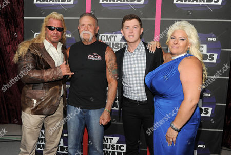 "Stock Picture of From left, Duane ""Dog"" Chapman, Paul Teutul, Sr., Scotty McCreery and Beth Chapman arrive at the 2013 CMT Music Awards at Bridgestone Arena, in Nashville, Tenn"