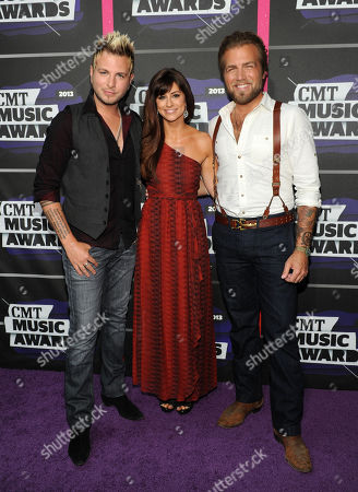 From left, Mike Gossin, Rachel Reinert and Tom Gossin, of musical group Gloriana, arrive at the 2013 CMT Music Awards at Bridgestone Arena, in Nashville, Tenn