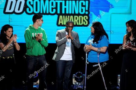 From left, nominees Sasha Fisher of Spark Microgrants, Ben Simon of Food Recovery Network, winning nominee Daniel Maree of Millionhoodies Movement for Justice, and nominees Lorella Praeli of United we DREAM and Jillian Mourning of All We Want is L.O.V.E. are seen onstage at the 2013 Do Something Awards, on in Hollywood, Calif