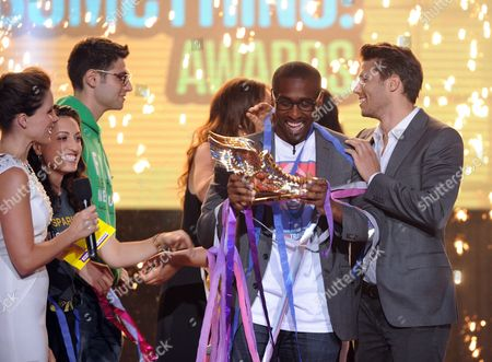 Host Sophia Bush, left, winning nominee Daniel Maree of Millionhoodies Movement for Justice, center, and presenter Jason Dundas, right, are seen onstage at the 2013 Do Something Awards, on in Hollywood, Calif