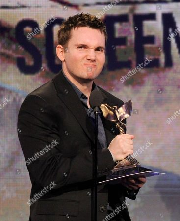 Derek Connolly accepts the best first screenplay award at the Independent Spirit Awards, in Santa Monica, Calif