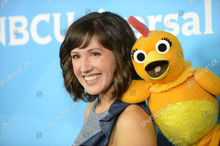 """Stock Photo of Kelly Vrooman, left, and Chica the Chicken of """"The Chica Show"""" arrive at the 2013 NBCUniversal Summer Press Day at The Langham Huntington Hotel and Spa on in Pasadena, Calif"""