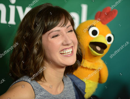 """Stock Picture of Kelly Vrooman, left, and Chica the Chicken of """"The Chica Show"""" arrive at the 2013 NBCUniversal Summer Press Day at The Langham Huntington Hotel and Spa on in Pasadena, Calif"""