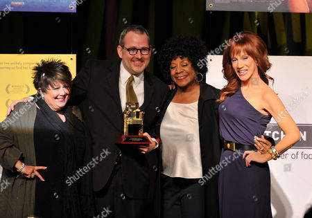 Singer Tata Vega, Morgan Neville, singer Merry Clayton, and Kathy Griffin speak onstage at the 2014 AARP's Movies for Grownups Gala, on Monday, Feb. 10th, 2014 in Beverly Hills, Calif