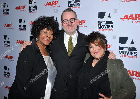 From left, singer Merry Clayton, Morgan Neville, and singer Tata Vega arrive at the 2014 AARP's Movies for Grownups Gala, on Monday, Feb. 10th, 2014 in Beverly Hills, Calif