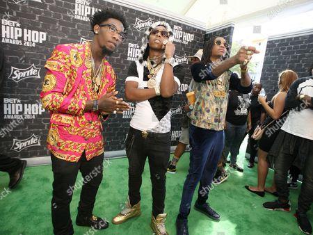 "Stock Photo of Migos (l-r: Kiari ""Offset"" Cephus, Kirshnik ""Takeoff"" Ball and Quavious ""Quavo"" Marshall) was seen arriving at the 2014 BET Hip Hop Awards held at the Atlanta Civic Center, in Atlanta, Ga"