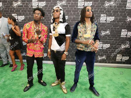"Migos (l-r: Kiari ""Offset"" Cephus, Kirshnik ""Takeoff"" Ball and Quavious ""Quavo"" Marshall) was seen arriving at the 2014 BET Hip Hop Awards held at the Atlanta Civic Center, in Atlanta, Ga"