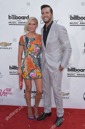 Caroline Boyer, left, and Luke Bryan arrive at the Billboard Music Awards at the MGM Grand Garden Arena, in Las Vegas