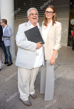 "Emmy nominee for outstanding costumes for a series, Eduardo Castro of ""Once Upon a Time,"" left, and Stana Katic seen at the Television Academy's 66th Emmy Awards Costume Design and Supervision Nominee Reception at the Fashion Institute of Design & Merchandising, in Los Angeles"