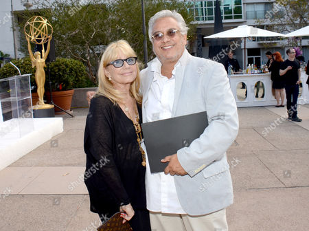 "Ellen Mirojnick, costumer designer of ""Behind The Candelabra"", left, and Eduardo Castro, costume designer of ""Once Upon A Time"", seen at the Television Academy's 66th Emmy Awards Costume Design and Supervision Nominee Reception at the Fashion Institute of Design & Merchandising, in Los Angeles"