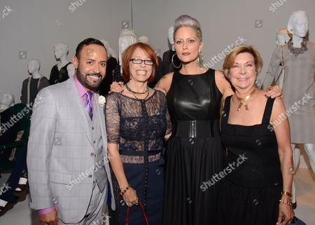"""Nick Verreos, FIDM spokesperson and fashion designer, and from left, Diane Crooke, costume designer for """"Parenthood,"""" Mandi Line, costume designer of """"Pretty Little Liars,"""" and Barbara Bundy, VP Education at FIDM seen at the Television Academy's 66th Emmy Awards Costume Design and Supervision Nominee Reception at the Fashion Institute of Design & Merchandising, in Los Angeles"""