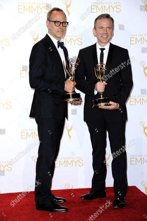 Tom Broecker, left, and Eric Justian pose in the press room with the award for outstanding costumes for a variety program or a special for their work on Saturday Night Live at the 2014 Creative Arts Emmys at Nokia Theatre L.A. LIVE, in Los Angeles